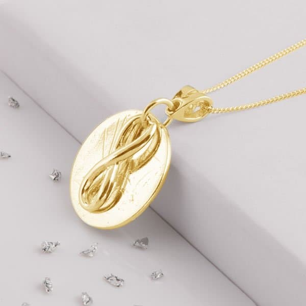 Love Knot Necklace Layered on Gold Disc