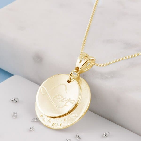 Overlaid disc pendant in gold