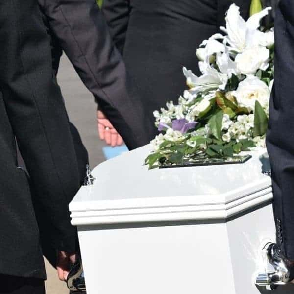 White Coffin Being Carried