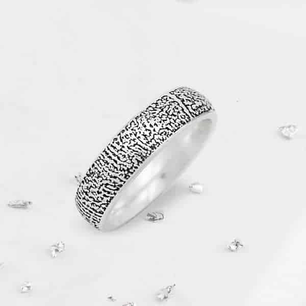 Fingerprint silver court ring close up