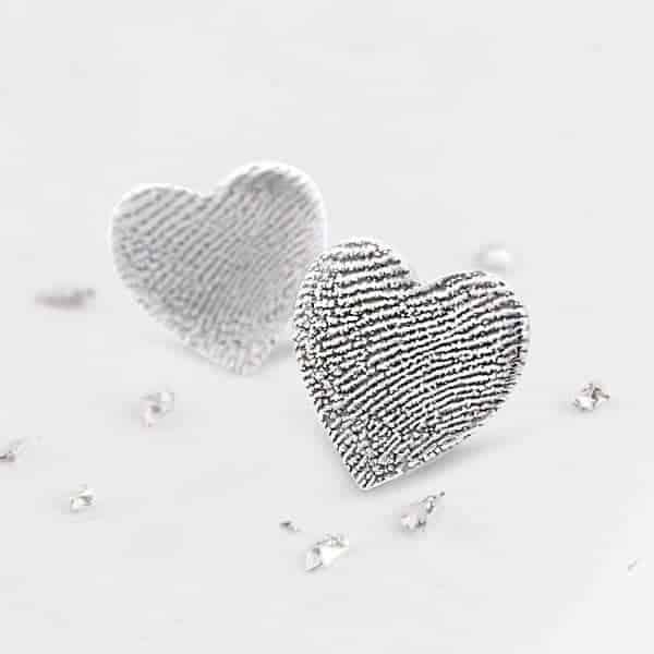 Heart shaped silver fingerprint earring studs close up