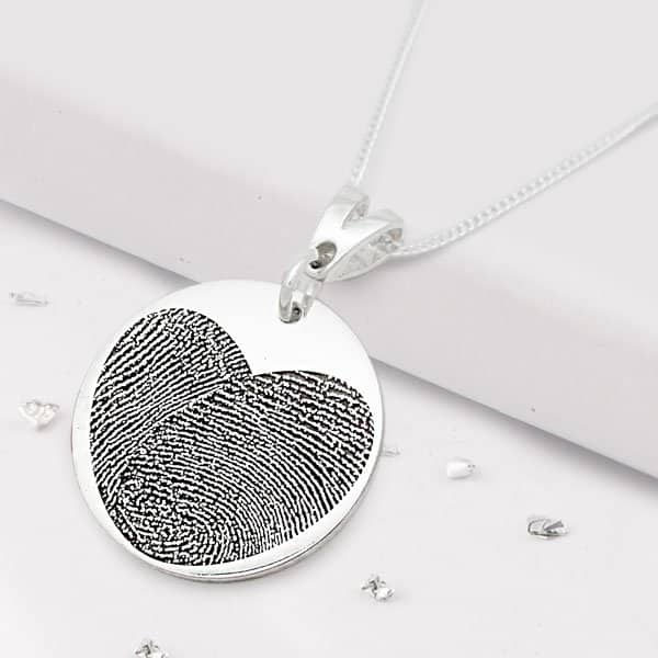 Silver round necklace with heart shaped fingerprint engraving