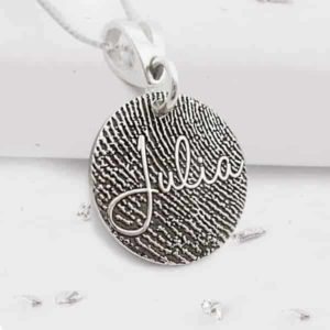 Fingerprint engraved silver disc necklace with engraved name close up