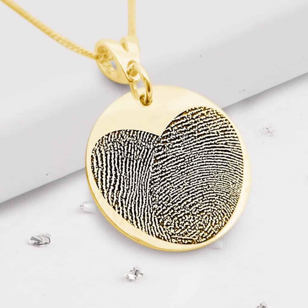 Gold fingerprint round pendant with heart engraving