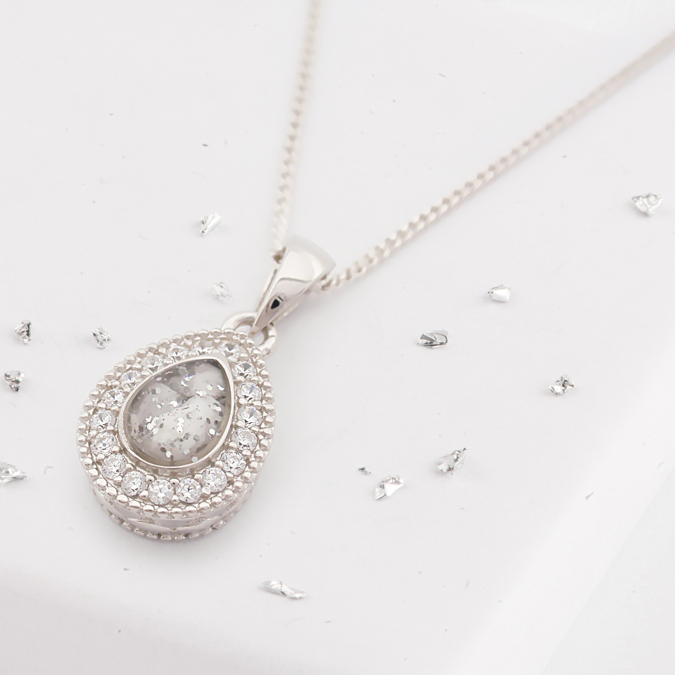 Small teardrop shaped ashes or hair crystal pendant